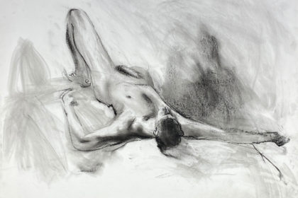 charcoal drawing of male model laying
